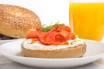 Bagel with cream cheese, salmon served with orange juice