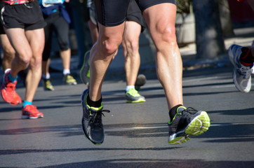 Marathon running race, people feet on road, sport concept