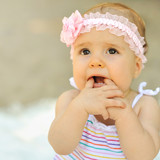 Beautiful cute baby - outdoor portrait. Closeup