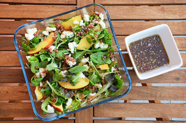 Spinach salad with goat cheese, nectarines and challot dressing