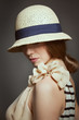 Stylish woman in retro wicker hat