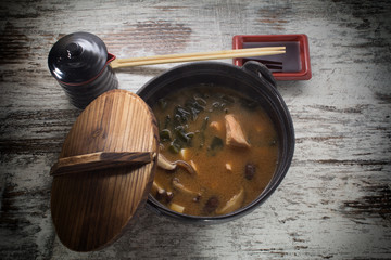 soup with tofu and seaweed on a vintage background