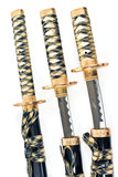 Three Japanese samurai katana swords over white