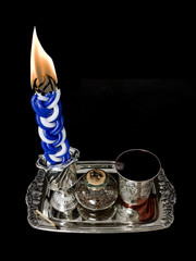 Havdala candle,wine,kiddush cup,spice set.Isolated on black.