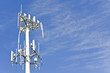Leinwanddruck Bild - Cell phone telecommunication tower,blue sky,wispy clouds