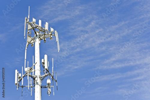 Leinwanddruck Bild Cell phone telecommunication tower,blue sky,wispy clouds