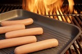 Sausages put on the grill pan