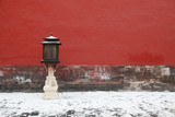 The red lanterns beside the wall of the Forbidden City