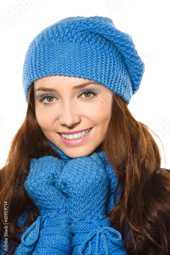 Young happy woman wearing winter cloth