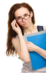 Young student girl is holding book