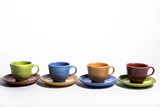 Row of colorful cups and saucers