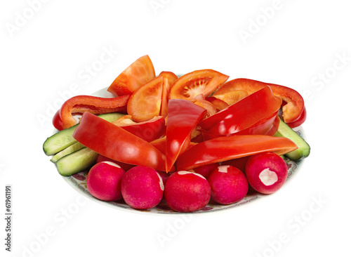 Plate with cut ​​vegetables. Isolated