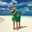 canvas print picture - Couple in green on a beach at Maldives