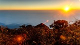 4K Timelapse, Sunrise through flowing cloud waves on hill.
