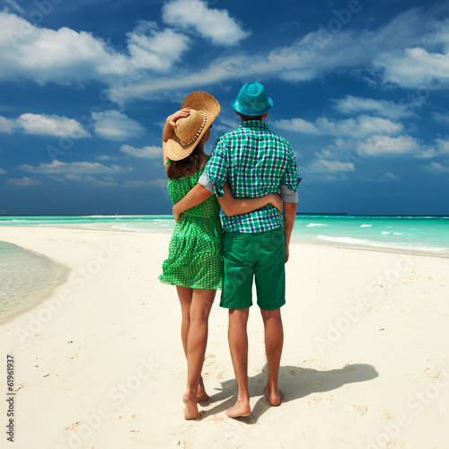 canvas print picture Couple in green on a beach at Maldives