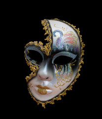 Women's carnival mask isolated on black background