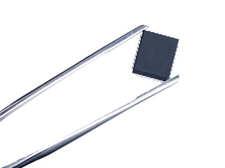 computer chip with tweezers, isolated