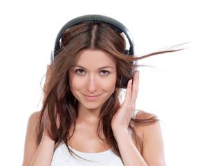 Happy woman listening music in big headphones earphones