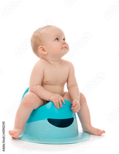 Infant child baby boy toddler sitting on potty toilet stool pot