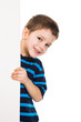 Boy peek out from vertical white banner