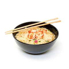 Shrimp and noodle soup bowl with chopsticks