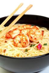 Shrimp and noodle soup bowl with chopsticks