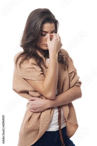Young woman with big headache