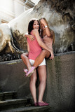 Toned outdoor photo of two girls hugging on street