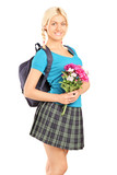 Young schoolgirl holding bouquet of flowers