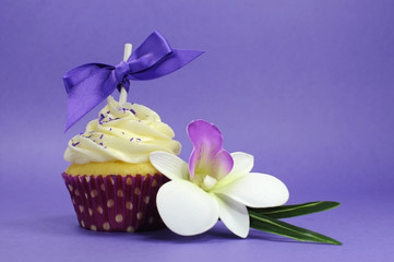 Purple theme cupcake with orchid flower