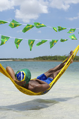 Man Relaxing in Hammock on Brazilian Beach