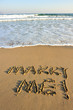 marry me word drawn on beach