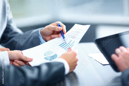 Businessman holding digital tablet at meeting