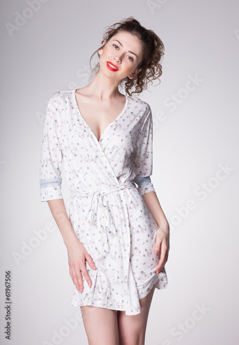 beautiful woman wearing pajamas - studio shot on grey