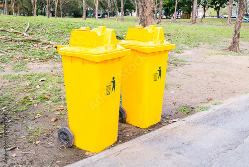 Yellow bins in the park.