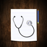 Stethoscope with pencil on wood background