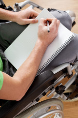 Disabled man holding a notebook