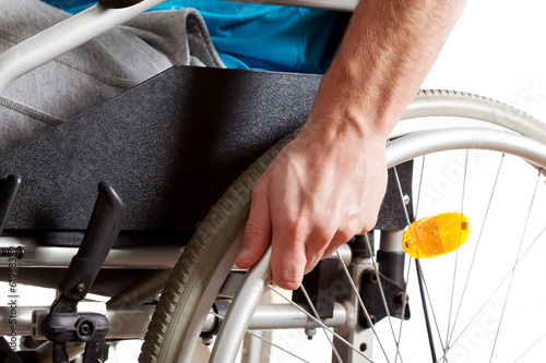 Wheelchair and hand closeup