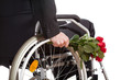 Wheelchair and roses closeup