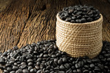 Coffee bean in basket on wooden background