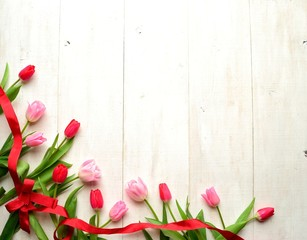 Pink tulips with red ribbon