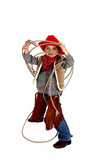 Adorable young cowboy wearing chaps, boots, and hat playing with poster