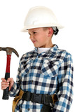 playful young boy wearing a hardhat and holding a hammer
