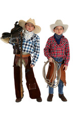 two young cowboys holding a saddle and a rope