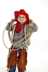 funny young cowboy with floppy ears smiling holding a rope