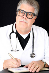 hilariously funny medical doctor huge eyes writing prescription