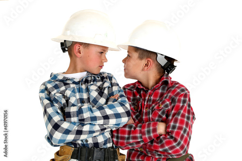 two young  brothers sneering at each other wearing construction