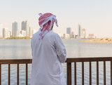 Portrait of an unknown Arab men on the waterfront in Sharjah, UA