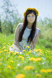 girl sitting  in dandelion wreath
