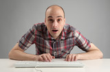 shocked man using keyboard